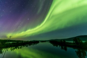 """Crazy strong aurora on a clear autumn night. I shot this in -14"""