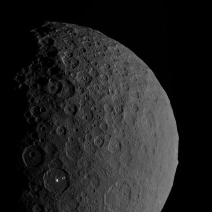 Beauty shot of Ceres, showing both Occator crater with its two bright spots, and the curious Ahuna mons (just on the edge of the limb to the right).