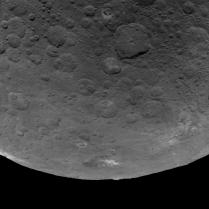 A nice view of Ceres taken from a higher orbit, showing several bright salt deposits.