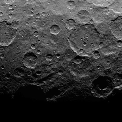 A moody shot of Cerean craters falling into shadow at the terminator – the boundary between Ceres' day side and night side.